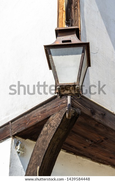 Lamp on the old wooden house