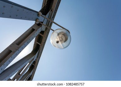 Lamp on a steel bridge, on a sunny afternoon