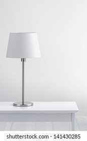 lamp on the table and blank space with white wall background