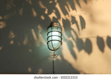 Lamp on the wall in afternoon.