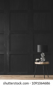 Lamp on wooden table in black empty living room interior with copy space