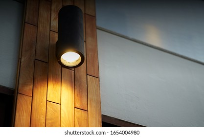 lamp on wooden tile decoration pole with turn on light in dark time