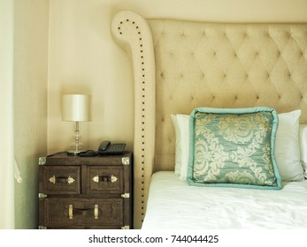 Lamp and phone on side table in bedroom