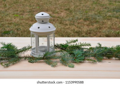 Lamp with pine tree branches in wooden table