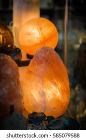 The lamp placed inside of the salt stone. Vertical indoors shot.