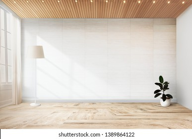 Lamp and a plant in an empty room wall mockup