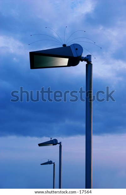 lamp posts in evening light with cloudy background