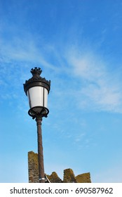 A lamp stood against the sky
