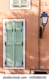 Lamp and window with shutters in Villefranche sur Mer, France