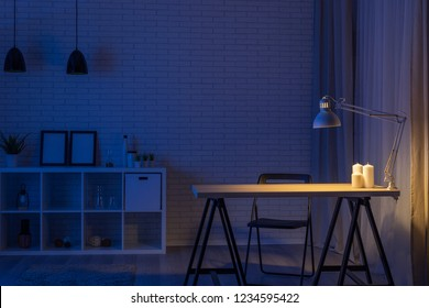 Lamp and work desk at night, overtime concept