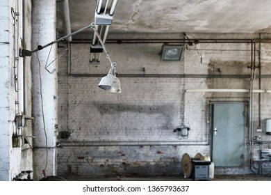Lamp at a workplace in a disused abandoned workshop