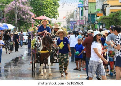 LAMPANG - THAILAND, April 13, 2017 : Songkran Festival Parade Traditional culture and Traditional Horse Carriage Procession Lanna style in Lampang province northern of Thailand.