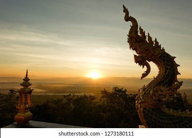 "Lampang, Thailand - Dec 23, 2018 : The pictures of Stucco art in a the temple on the north of Thailand called ""Wat Doi Prachan"" which a lot of stucco of the beautiful great naga or king of naga."
