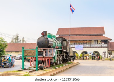 Lampang, Thailand - February 18, 2018: Historic steam locumotive displayed in front of railway station.
