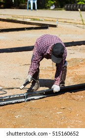 LAMPANG, THAILAND - NOVEMBER 5 : unidentified thai worker preparing the area for pouring concrete to make plaza on November 5, 2016 in Lampang, Thailand.
