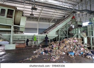 LAMPANGPROVINCE, THAILAND-DECEMBER 7 2016, Women in sepate line collect the plastic and metallic waste from household in waste disposal factory. Recyclable waste in dump site