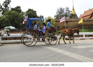 LAMPANG,THAILAND,JAN 20, 2017: Tourists ride the horse carriage in Wat Phra That Lampang Luang in Lampang, Thailand.