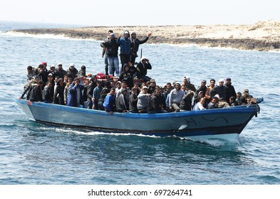 LAMPEDUSA ITALIA  APRIL 1, 2011  landings clandestine migrant boat at Lampedusa harbor