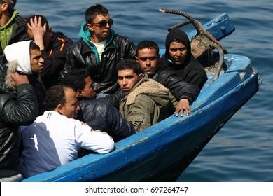 LAMPEDUSA ITALIA  MARCH 26, 2011 landings clandestine migrant boat at Lampedusa harbor