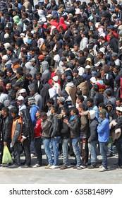 LAMPEDUSA ITALIA  MARCH 27, 2011 clandestine migrant lines for breackfast at Lampedusa harbor