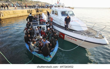 LAMPEDUSA ITALIA  MARCH 27, 2011 landings clandestine migrant boat at Lampedusa harbor