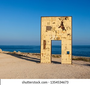 LAMPEDUSA, ITALY - AUGUST, 03: Sculpture of an open door greets the sea realised by the italian artist Mimmo Paladino. It's called La Porta d'Europa - the door of Europe  on August 03, 2018