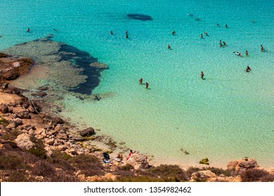 LAMPEDUSA, ITALY - AUGUST, 03: View of the most famous sea place of Lampedusa, It is named Spiaggia dei conigli,  in English language Rabbits Beach or Conigli island on August 03, 2018