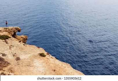LAMPEDUSA, ITALY - AUGUST, 04: Couple canoeing in the Lampedusa sea on August 04, 2018