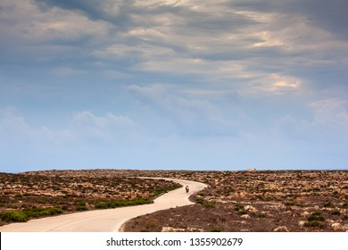 LAMPEDUSA, ITALY - AUGUST, 04: Road in the Lampedusa countryside in the summer season on August 04, 2018
