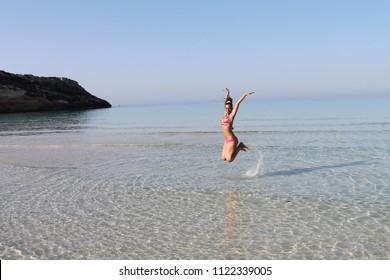 Lampedusa, Italy - July 23rd, 2018: people enjoys the wonderful sea in the island of Lampedusa