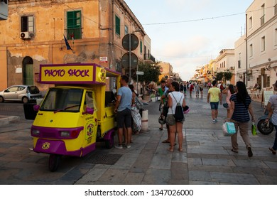 LAMPEDUSA, ITALY - JULY, 31: View of  traditional italian three-wheeled called Ape Piaggio used to sell touristic picture in Lampedusa on July 31, 2018