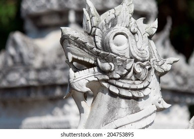 LAMPHUM, THAILAND - FEBRUARY 10: Ancient dragon sculptures in temple Phra Yuen in Lamphum, Thailand, Province Chang Mai, February 10, 2014. Church was built in 11th century