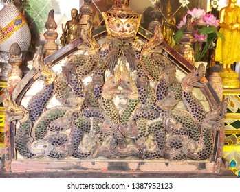 LAMPHUN PROVINCE/ THAILAND-OCTOBER 11, 2018: Ancient art of wood carving as nagas and god for using as seven candle pitching in the temple, meaning of the holy mountain called Sattapan (Candelabrum)