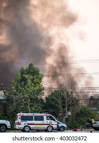 Lamphun, Thailand - April 9, 2016:Fire recycling warehouse, causing a large flame and smoke in the air is very hot days. Firemen rush to help prevent the spread of fire , In Thailand.