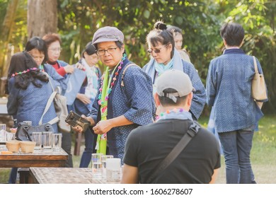 LAMPHUN THAILAND - DECEMBER 12 :  Unidentified Thai female tourists learn to make a necklace from a yarn ball on December12,2019 at Karen village in Lamphun, Thailand