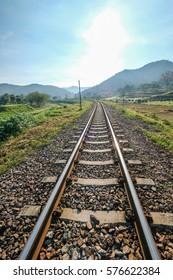 LAMPHUN , THAILAND - JAN 20 : The train rail with mountain scene at Lamphun , Thailand on Jan 20 2017.