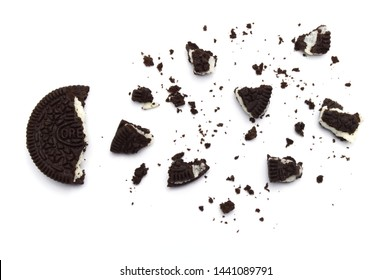 LAMPHUN, THAILAND - JULY 3, 2019: Oreo Biscuits with crumbs on white background. It is a sandwich cookies filled with chocolate cream flavored. The best selling dessert in Thailand.