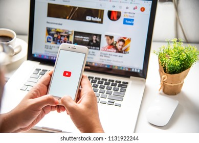 LAMPHUN, THAILAND - July 8, 2018: In a hand for man with social networking service Youtube on the screen IPhone6.YouTube is the popular online video sharing website.