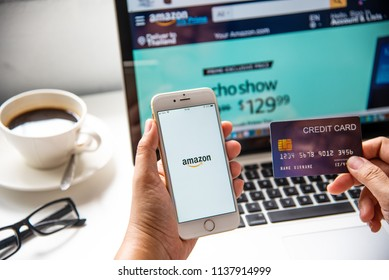 LAMPHUN, THAILAND - July 8, 2018: In a hand for man with social networking service Amazon app on a Apple iPhone 6 screen. Amazon is one of the largest online shopping websites.