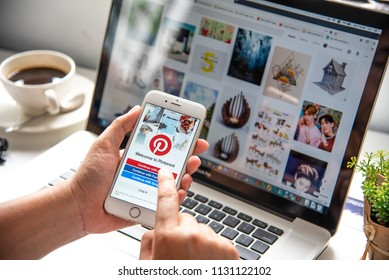 LAMPHUN, THAILAND - JULY 8th, 2018: Hand holding Apple Iphone6 gold color with Pinterest app on the screen. Pinterest is an online pinboard that allows people to pin their interesting things.