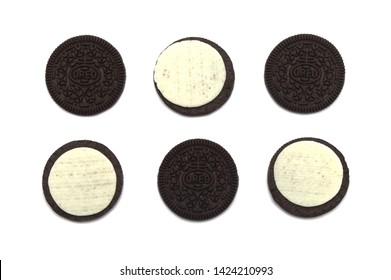 LAMPHUN, THAILAND - JUNE 14, 2019: Oreo Biscuits in pieces of outside and inside isolated on white background. It is a sandwich chocolate cookies with a sweet cream.
