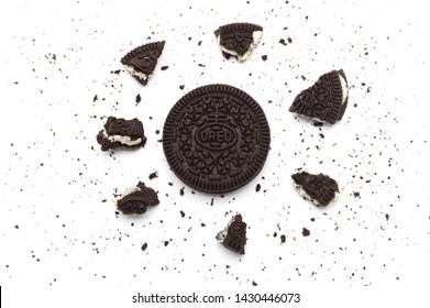 LAMPHUN, THAILAND - JUNE 21, 2019: Oreo Biscuits with crumbs on white background. It is a sandwich chocolate cookies with a sweet cream is the best selling dessert in Thailand.