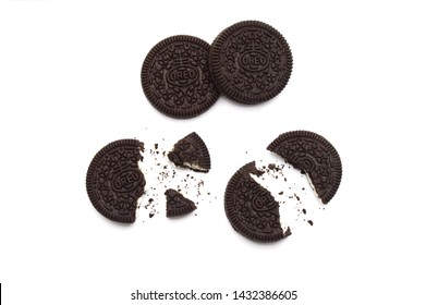 LAMPHUN, THAILAND - JUNE 24, 2019: Oreo Biscuits with crumbs on white background. It is a sandwich chocolate cookies with a sweet cream is the best selling dessert in Thailand.
