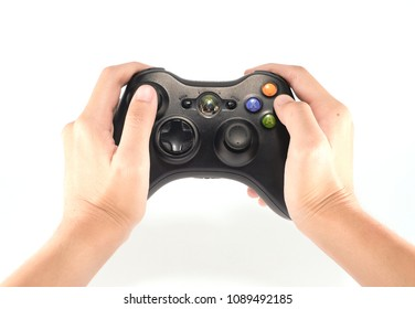 Lamphun,Thailand - May 13, 2018: The Microsoft Xbox 360 Controller, a gamepad for the Xbox, isolated on white background.isolated hand holding black joystick x-box 360.