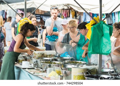 L'Ampolla,Spain-August 09,2017: L'Ampolla market.Olives on the weekly market in L'Ampolla,Spain.