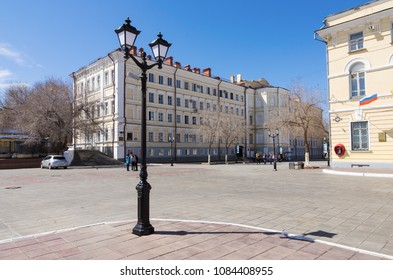 Lamppost at the corner of Naberezhnaya and Sovetskaya streets. The picture was taken in Russia, in the city of Orenburg. 04/17/2018