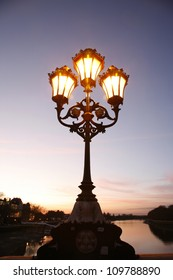 Lamppost at dusk on Putney Bridge, London
