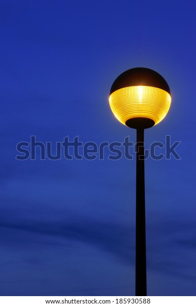 lamppost illuminated at twiligh