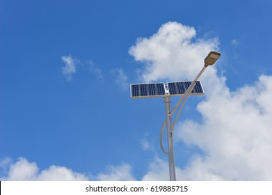 Lamppost with the solar panel on sky background