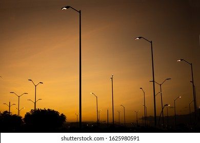 Lamppost at sunset. street lamps over background of a dramatic sky